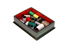 Wooden casket with colorful threads isolated Stock Photos