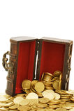 Wooden casket full of coins Stock Image