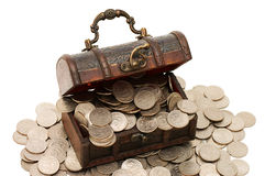 Wooden casket full of coins Stock Photo