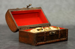 Wooden Casket Full Of Coins Stock Photography