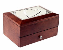 Wooden casket with heart on top. On white isolated background Stock Photo