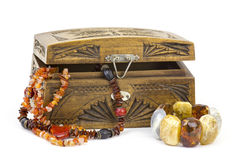 Wooden casket with jewellery Stock Photos