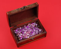 Wooden casket with jewelry Royalty Free Stock Image