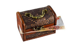 Wooden casket with paper money Stock Images