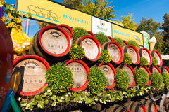 Wooden casks stacked outdoors at Oktoberfest at sunny day: Erfur Royalty Free Stock Image