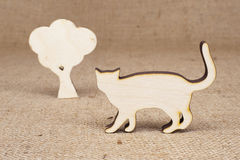 Wooden cat figure with tree Royalty Free Stock Photo