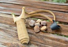 Wooden catapult slingshot Stock Image