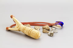 Wooden catapult slingshot with stone bullets Stock Images