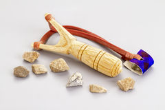 Wooden catapult slingshot with stone bullets Royalty Free Stock Photo
