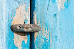 A wooden catch. A wooden lock-turntable or gate valve on the door of the old barn. Close-up. A wooden catch. A wooden gate valve on the door of the old barn royalty free stock images