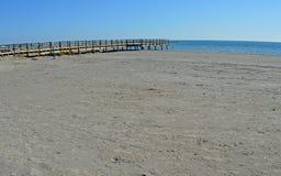 Wooden Causeway - Empty Sandy Beach Stock Images