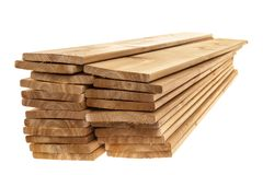 Wooden cedar boards piled. Stacks of one by six inch cedar boards on white background Stock Image