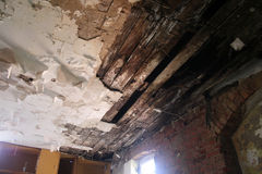 Wooden ceiling. Abandoned and very devastated factory stock photo