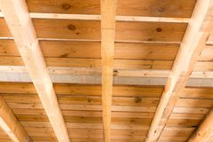 The wooden ceiling as background. Photo of an abstract texture Stock Images