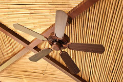 Wooden ceiling fan on a bamboo ceiling Stock Photography