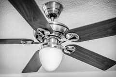 Wooden ceiling fan with light Stock Images