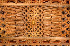 Wooden ceiling with paintings of 14th centuryl Madraza de Granada royalty free stock photo