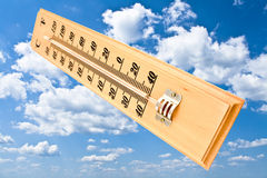Wooden celsius fahrenheit thermometer Royalty Free Stock Photography