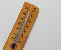 Wooden Celsius thermometer with blue dial Stock Photo