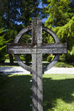 Wooden celtic cross on grave. Stock Photos
