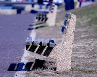 Wooden and cemented benches lined up royalty free stock photos