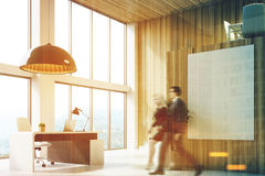 Wooden CEO office with a poster, people, corner Stock Photography