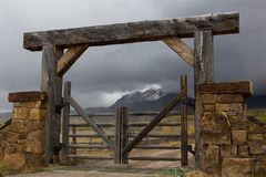 Wooden chained ranch gate and stone pillars stock photos