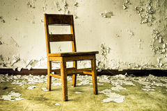 Wooden Chair in Abandoned Building stock photos