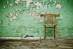 Wooden Chair in Abandoned place Stock Photo