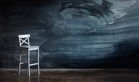 Wooden chair against a school desk for the letter Stock Photography