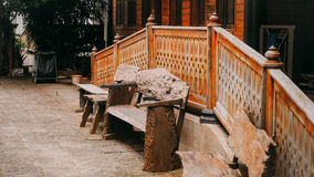 Wooden chair archaic. Wooden chairs in front of a bungalow Stock Image