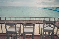 Wooden chair on balcony. Beside sea beach at Thailand stock image