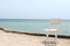 Wooden chair at the beach Stock Photo