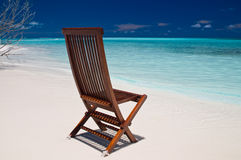 Wooden chair on a beach Royalty Free Stock Photo