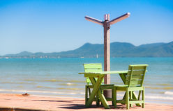 Wooden chair on the beach Royalty Free Stock Images