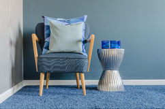 Wooden chair with blue color pillow on carpet Royalty Free Stock Photography