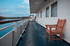 Wooden chair on the deck of cruise liner Royalty Free Stock Images