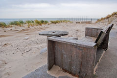 Wooden chair in dunes. With sea in background royalty free stock image