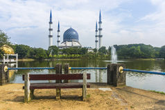 Wooden chair facing to mosque Stock Image