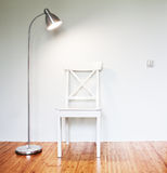 Wooden Chair with floor lamp Royalty Free Stock Photography