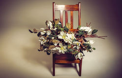 Wooden chair and flowers Royalty Free Stock Photo
