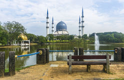 Wooden chair in front of mosque Royalty Free Stock Images