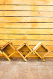 Wooden chair on the in front of the wall wood Royalty Free Stock Photos