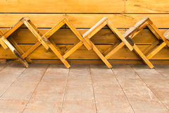 Wooden chair on the in front of the wall wood Stock Photography