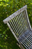 Wooden chair in a garden Stock Images