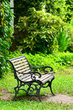 Wooden chair in garden on dingy light day Stock Photos