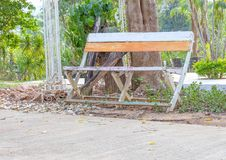 Wooden chair in the garden Resting. Place nature Under the tree royalty free stock photography