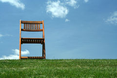 Wooden chair on a hilltop Stock Photography