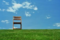 Wooden chair on a hilltop Royalty Free Stock Photo