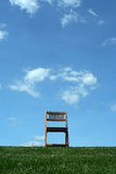 Wooden chair on a hilltop Stock Photo